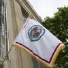 Photo -  The city's flag, which features the city's seal surrounded by red border, hangs from a building in downtown Oklahoma City.   PHOTOS PROVIDED  <strong></strong>