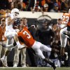 Texas\' Jordan Shipley (8) catches a pass as OSU\'s Victor Johnson (3) and Terrance Anderson (23) defend during the college football game between the Oklahoma State University Cowboys (OSU) and the University of Texas Longhorns (UT) at Boone Pickens Stadium in Stillwater, Okla., Saturday, Oct. 31, 2009. Photo by Sarah Phipps, The Oklahoman