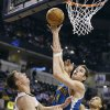 New Orleans Hornets\' Jason Smith, center, shoots against Indiana Pacers\' Tyler Hansbrough, left, and Gerald Green during the first half of an NBA basketball game, Wednesday, Nov. 21, 2012, in Indianapolis. (AP Photo/Darron Cummings)