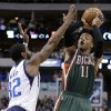 Dallas Mavericks\' O.J. Mayo (32) defends as Milwaukee Bucks\' Monta Ellis (11) shoots during the first half of an NBA basketball game Tuesday, Feb. 26, 2013, in Dallas. (AP Photo/Tony Gutierrez)