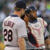 Photo -   Cleveland Indians' Corey Kluber, left, speaks with catcher Carlos Santana in the third inning of a baseball game against the Oakland Athletics on Saturday, Aug. 18, 2012, in Oakland, Calif. (AP Photo/Ben Margot)