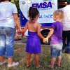 Small girls hold hands as they wait in line to see the inside of an EMSA ambulance at the park. Residents of the Riverpark Neighborhood gathered at Tulsa Park near SW 24 and Tulsa Saturday afternoon, Sep. 11, 2010, to take part in National Night Out activities. by Jim Beckel, The Oklahoman