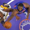 Los Angeles Lakers guard Kobe Bryant, left, puts up a shot as Detroit Pistons forward Jason Maxiell defends during the first half of their NBA basketball game, Sunday, Nov. 4, 2012, in Los Angeles. (AP Photo/Mark J. Terrill)