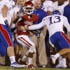 OU\'s Jalen Saunders (14) tries to get past KU\'s Ron Doherty (13) during the college football game between the University of Oklahoma Sooners (OU) and the Kansas Jayhawks (KU) at Gaylord Family-Oklahoma Memorial Stadium in Norman, Okla., Saturday, Oct. 20, 2012. Photo by Bryan Terry, The Oklahoman