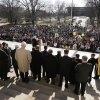 Photo - Abortion opponents gather for a rally at the Kansas Statehouse, on the 40th anniversary of Roe v. Wade, in Topeka, Kan., Tuesday, Jan. 22, 2013. Gov. Sam Brownback has signed a series of tough, anti-abortion measures during his first two years in office. Much to the dismay of abortion-rights advocates, Kansas has been part of a wave in which states with Republican governors and GOP-controlled Legislatures enacted new restrictions on abortion providers.  (AP Photo/Orlin Wagner)
