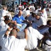 A church volunteer prays with a group of inmates in a prison yard as part of a Bill Glass Weekend of Champions event. Photo provided