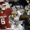 Oklahoma\'s Cameron Kenney (6) pushes Connecticut\'s Harris Agbor (25) on his way to a touchdown during the Fiesta Bowl college football game between the University of Oklahoma Sooners and the University of Connecticut Huskies in Glendale, Ariz., at the University of Phoenix Stadium on Saturday, Jan. 1, 2011. Photo by Bryan Terry, The Oklahoman