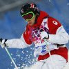 Canada\'s Alex Bilodeau runs the course during the men\'s moguls qualifying at the Rosa Khutor Extreme Park at the 2014 Winter Olympics, Monday, Feb. 10, 2014, in Krasnaya Polyana, Russia. (AP Photo/Sergei Grits)