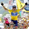 FILE - In this July 22, 2004, file photo, Lance Armstrong reacts as he crosses the finish line to win the 17th stage of the Tour de France cycling race between Bourd-d\'Oisans and Le Grand Bornand, French Alps. In 2004, Armstrong was also named Associated Press Male Athlete of the Year and ESPN\'s ESPY Award for Best Male Athlete. (AP Photo/Laurent Rebours, File)