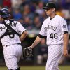Photo - Colorado Rockies catcher Michael McKenry, left, congratulates starting pitcher Tyler Matzek after he retired the Atlanta Braves in the sixth inning of a baseball game in Denver on Wednesday, June 11, 2014. (AP Photo/David Zalubowski)