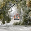 WINTER / COLD / WEATHER / ICE STORM / OG&E / AFTERMATH: An OGE truck framed in trees downed by ice at NW 42 and Shartel in the Crown Heights housing addition in Oklahoma City Monday, Dec. 10, 2007. OGE crews were assessing the damage to downed power lines in Crown Heights. By Paul B. Southerland, The Oklahoman ORG XMIT: KOD