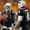 OSU\'s Zac Robsinson, left, and Brandon Weeden talk before the college football game between Oklahoma State University (OSU) and the University of Colorado (CU) at Boone Pickens Stadium in Stillwater, Okla., Thursday, Nov. 19, 2009. Photo by Nate Billings, The Oklahoman