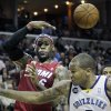 Miami Heat\'s LeBron James (6) passes the ball over Memphis Grizzlies\' Marreese Speights during the first half of an NBA basketball game in Memphis, Tenn., Sunday, Nov. 11, 2012. (AP Photo/Danny Johnston)