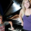 Madeline Bentley and Sam Lower pose with their school\'s antique piano at Classen SAS in Oklahoma City on Monday, August 23, 2010. The students are raising money to refurbish the piano. Photo by John Clanton, The Oklahoman