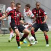 Photo - Frankfurt's Bastian Oczipka, left, and Bamba Anderson, right, and Bayern's Mario Mandzukic of Croatia challenge for the ball during a German soccer Bundesliga match between Eintracht Frankfurt and Bayern Munich in Frankfurt, Germany, Saturday, Aug. 17, 2013. (AP Photo/Michael Probst)