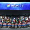 Flag-bearers hold national flags during a ceremony on the eve of the Expo 2012 in Yeosu, South Korea, Friday, May 11, 2012. The expo will open for three months on May 12 under the theme of