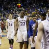 Photo - Kansas players walk off the court following their loss in a third-round game against Stanford at the NCAA college basketball tournament Sunday, March 23, 2014, in St. Louis. Stanford won the game 60-57. (AP Photo/Charlie Riedel)