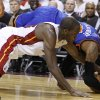 Miami Heat\'s Joel Anthony, left, and New York Knicks\' Carmelo Anthony, right, fight for the ball in the first half of an NBA basketball game in the first round of the Eastern Conference playoffs in Miami, Monday, April 30, 2012. (AP Photo/Lynne Sladky)