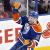 Photo - Edmonton Oilers' Jesse Joensuu celebrates a goal against the Carolina Hurricanes during the second period of an NHL hockey game in Edmonton, Alberta, on Tuesday, Dec. 10, 2013. (AP Photo/The Canadian Press, Jason Franson)