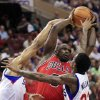 Photo -   Chicago Bulls' Luol Deng (9) looks to pass the ball as he is defended by Philadelphia 76ers' Lou Williams (23) and Andre Iguodala during the first quarter of Game 3 in an NBA basketball first-round playoff series in Philadelphia, Friday, May 4, 2012. (AP Photo/Mel Evans)