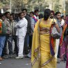 Photo -   Indian men watch participants walk during the 5th Delhi Queer Pride parade in New Delhi, India, Sunday, Nov. 25, 2012. Hundreds of gay rights activists marched through New Delhi on Sunday to demand that they be allowed to lead lives of dignity in India's deeply conservative society.(AP Photo/ Mustafa Quraishi)