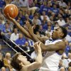 Kentucky\'s Archie Goodwin, right, shoots over Baylor\'s Brady Heslip during the first half of an NCAA college basketball game at Rupp Arena in Lexington, Ky., Saturday, Dec. 1, 2012. (AP Photo/James Crisp)