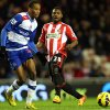 Sunderland\'s Stephane Sessegnon, right, has a shot toward\'s goal past Reading\'s Shaun Cummings, left, during their English Premier League soccer match at the Stadium of Light, Sunderland, England, Tuesday, Dec. 11, 2012. (AP Photo/Scott Heppell)