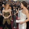 Jessica Chastain, left, and Milla Jovovich arrive before the 84th Academy Awards on Sunday, Feb. 26, 2012, in the Hollywood section of Los Angeles. (AP Photo/Chris Pizzello) ORG XMIT: OSC207