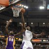 Photo -   Sacramento Kings guard Tyreke Evans, right, goes to the basket against Los Angeles Lakers forward Christian Eyenga during the first half of an NBA basketball game in Sacramento, Calif., Thursday, April 26, 2012. (AP Photo/Rich Pedroncelli)