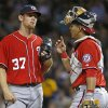 Photo - Washington Nationals starting pitcher Stephen Strasburg (37) gets a visit from catcher Wilson Ramos during the seventh inning of a baseball game against the Pittsburgh Pirates in Pittsburgh, Saturday, May 24, 2014. (AP Photo/Gene J. Puskar)