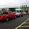 Cars line up for fuel at the Hess station on U.S. 9 North Woodbridge, N.J, Tuesday, Oct. 30, 2012. Eight oil refineries that make up about 8 percent of U.S. refining capacity sit in the area hit by Hurricane Sandy. Nearly all of them were affected by the superstorm. (AP Photo/Peter Hermann, III) ORG XMIT: NYR106