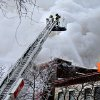 Photo - Firefighters work the scene where a fire engulfed several apartment units in the Cedar Riverside neighborhood, in Minneapolis, Wednesday, Jan. 1, 2014. Authorities say at least 13 people have been hurt. (AP Photo/Star Tribune, Elizabeth Flores)