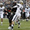 Oklahoma State\'s Jeremy Seaton (44) scores a touchdown as Purdue\'s Landon Feichter (44) tries to tackle him during the Heart of Dallas Bowl football game between Oklahoma State University and Purdue University at the Cotton Bowl in Dallas, Tuesday, Jan. 1, 2013. Photo by Bryan Terry, The Oklahoman