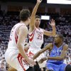 Oklahoma City\'s Kevin Durant (35) passes in between Houston\'s Omer Asik (3) and Chandler Parsons (25) during Game 3 in the first round of the NBA playoffs between the Oklahoma City Thunder and the Houston Rockets at the Toyota Center in Houston, Texas, Sat., April 27, 2013. Photo by Bryan Terry, The Oklahoman