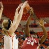 Oklahoma State\'s Liz Donohoe (4) blocks the shot of Oklahoma\'s Sharane Campbell (24) during the Bedlam women\'s college basketball game between Oklahoma State University and the University of Oklahoma at Gallagher-Iba Arena in Stillwater, Okla., Saturday, Feb. 23, 2013. OSU beat OU, 83-62. Photo by Nate Billings, The Oklahoman