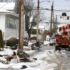 Utility workers check the power lines as snow covered debris from Superstorm Sandy lay on the side of a street following a nor\'easter storm, Thursday, Nov. 8, 2012, in Point Pleasant, N.J. The New York-New Jersey region woke up to wet snow and more power outages Thursday after the nor\'easter pushed back efforts to recover from Superstorm Sandy, that left millions powerless and dozens dead last week. (AP Photo/Julio Cortez) ORG XMIT: NJJC113