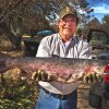 Photo -  Mark Reed of Bridge Creek holds the new state record rainbow trout caught from Lake Watonga