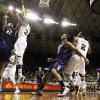Northwestern center Alex Olah (22) shoots against Baylor\'s Cory Jefferson (34) as Northwestern\'s Reggie Hearn and Baylor\'s Rico Gathers (2) watch in the first half of an NCAA college basketball game, Tuesday, Dec. 4, 2012, in Waco, Texas. (AP Photo/Tony Gutierrez)
