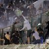 Photo - Panathinaikos fans throw seats at PAOK supporters shortly before the start of the Greek championship play-off match between their teams at Apostolos Nikolaidis stadium in Athens, Sunday, May 4, 2014. (AP Photo/InTime Sports)  GREECE OUT