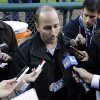 Photo -   New York Yankees general manager Brian Cashman talks to the media before Game 3 of the American League championship series against the Detroit Tigers Tuesday, Oct. 16, 2012, in Detroit. (AP Photo/Matt Slocum)