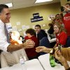 Republican presidential candidate, former Massachusetts Gov. Mitt Romney greets campaign workers during a visit to a voter call center in Green Tree, Pa., Tuesday, Nov. 6, 2012. (AP Photo/Charles Dharapak)