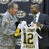 HIGH SCHOOL FOOTBALL / LT. GEN. BENJAMIN FREAKLEY: Lt. Gen. Benjamin C. Freakley presents an Army All-American jersey to Barry Sanders during a ceremony at Heritage Hall High School in Oklahoma City , Monday, October 4, 2011. Photo by Steve Gooch ORG XMIT: KOD