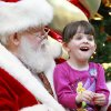 Sara Bellamy, 4, tells Santa Claus what she wants for Christmas at Penn Square Mall, Tuesday , December 13, 2010. Photo by David McDaniel, The Oklahoman