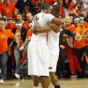 OSU\'s Matt Pilgrim (31), left, and Obi Muonelo (2) hug as fans take the court at the end of the men\'s college basketball game between the University of Kansas (KU) and Oklahoma State University (OSU) at Gallagher-Iba Arena in Stillwater, Okla., Saturday, Feb. 27, 2010. OSU won, 85-77. Photo by Nate Billings, The Oklahoman