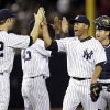 New York Yankees relief pitcher Mariano Rivera, second from right, and catcher Francisco Cervelli high-five teammates after their 4-3 win over the Arizona Diamondbacks in a baseball game at Yankee Stadium in New York, Wednesday, April 17, 2013. (AP Photo/Kathy Willens)