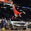 Los Angeles Clippers\' Blake Griffin dunks over a car as teammate Baron Davis looks on from inside the car during the Slam Dunk Contest at the NBA basketball All-Star weekend, Saturday, Feb. 19, 2011, in Los Angeles. (AP Photo/Mark J. Terrill)