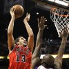 Chicago Bulls\' Joakim Noah (13) shoots over Phoenix Suns\' P.J. Tucker (17) during the first half of an NBA basketball game, Wednesday, Nov. 14, 2012, in Phoenix. (AP Photo/Ross D. Franklin)