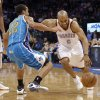 Oklahoma City Thunder\'s Derek Fisher (6) drives past New Orleans Hornets\' Brian Roberts (22) during the NBA basketball game between the Oklahoma City Thunder and the New Orleans Hornets at the Chesapeake Energy Arena on Wednesday, Feb. 27, 2013, in Oklahoma City, Okla. Photo by Chris Landsberger, The Oklahoman