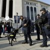 Police officers patrol in front of Yankee Stadium before a baseball game between the New York Yankees and Arizona Diamondbacks in New York, Tuesday, April 16, 2013. Signs of increased security were visible in the wake of the Boston Marathon explosions. (AP Photo/Kathy Willens)