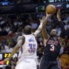 Miami Heat guard Dwyane Wade (3) shoots over Oklahoma City Thunder small forward Kevin Durant (35) during the second period of an NBA basketball game in Miami, Wednesday, Jan. 29, 2014. (AP PhotoAlan Diaz)